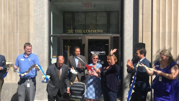 A ribbon cutting event at 202 The commons, the new CFCU Community Credit Union Transformation Center, in downtown Ithaca. Celebrating are key members of the Credit Union staff, the Ithaca NY mayor and staff from the Downtown Ithaca alliance.